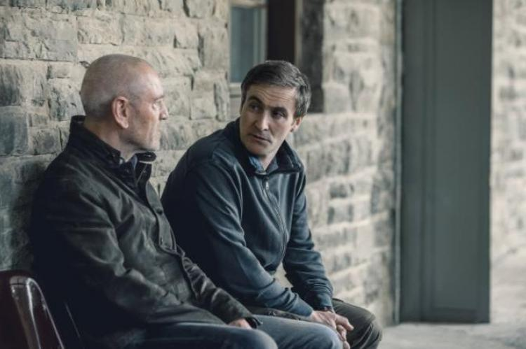 Adam Gettrick (Derek Riddell, right) with Julien Baptiste (Tcheky Karyo)