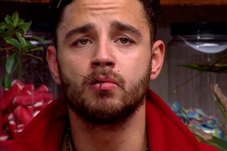 Adam Thomas holds a spider in his mouth