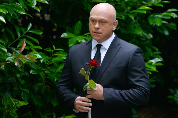Grant Mitchell hides in the bushes