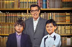 Contestants Morgan and Christopher with host Richard Osman in Child Genius