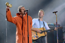 Liam Gallagher (L) and Chris Martin of Coldplay perform on stage